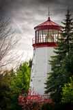 Old Lighthouse Nestled Among Trees Stock Image