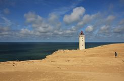 Old lighthouse partly covered by a high sand dune. Rubjerg Knude, Denmark. Stock Photography