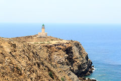 Old lighthouse on peninsula Prasonisi in Rhodes Royalty Free Stock Photos