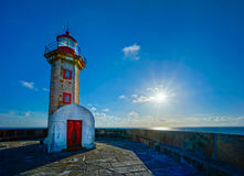 Old lighthouse in Porto. Portugal, sunny evening, calm ocean Royalty Free Stock Photo