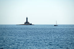 Old lighthouse on a rock island Royalty Free Stock Photo