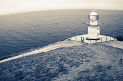 Old lighthouse on rock Royalty Free Stock Image