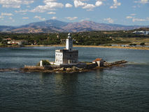 Old Lighthouse in the Sea. An old lighthouse guards the coast nearby the Olbia bay, Sardinia royalty free stock image