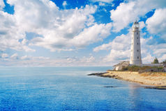 Old lighthouse on sea coast Stock Photos