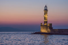 Old lighthouse. Old lighthouse at sunset. The city of Chania. Crete Stock Photos