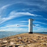 Old lighthouse in Swinoujscie, a port in Poland on the Baltic Se. A. The lighthouse was designed as a traditional windmill. Panoramic square image Royalty Free Stock Images