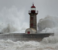 Old lighthouse under heavy storm Stock Images