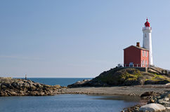 An old lighthouse on the west coast. Fisgard Lighthouse national Historic Site Royalty Free Stock Images