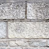Old limestone brick wall fragment Royalty Free Stock Images