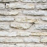 Old limestone brick wall fragment Stock Photography