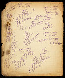 Old lined paper sheet with calculations and dirty borders. Ink pen marks Royalty Free Stock Images