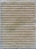 Old lined paper texture. Texture of a sheet of old grey lined paper with some wrinkles Royalty Free Stock Photography