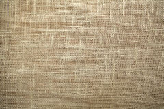 Old linen - fabric background. Old beige linen closeup. Visible fibers Royalty Free Stock Images