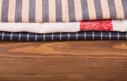 Old linen kitchen towels on dark wood. With copy space Royalty Free Stock Images