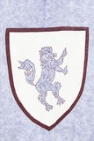 Old lion in a shield Stock Photography