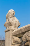 Old Lion Stone Sculpture in Korea Style. In Palace with Blue Sky before Sunset Royalty Free Stock Image