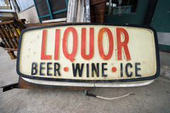 Old liquor store sign. In a pawn shop in Texas USA Royalty Free Stock Image