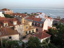 Old Lisbon. Tile roofs in the old Lisbon centre Alfama, River tejo in the background Stock Images