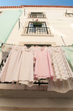 An old Lisbon house with the linen drying outside the buiding Stock Images