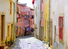 Old Lisbon street in a beautiful summer day stock photos