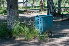 Old litter bin in the park. Old Soviet-era abandoned playground Stock Image