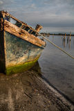 Old little boat on the shore in the bay Stock Photography
