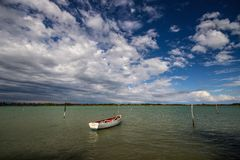 Old little boat on the water in the bay Royalty Free Stock Images
