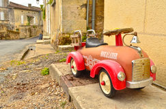 Old little car. In Saint Emilion stock photography
