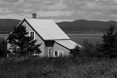Old little house in the field by the sea. Black and white photos Stock Image