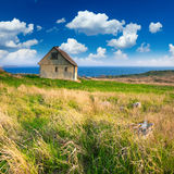 Old little house by the seaside Royalty Free Stock Image