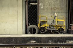 Old Little speeder gang cars or Railway bogie trolley yellow. Used duty to patrol repair railroad tracks parked on footpath at train station Bang Khen Bangkok Royalty Free Stock Images
