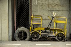 Old Little speeder gang cars or Railway bogie trolley yellow. Used duty to patrol repair railroad tracks parked on footpath at train station Bang Khen Bangkok Stock Images