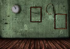 Old Living room. Old grungy room with clock and frames Royalty Free Stock Image