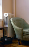 Old living room. Showing steam radiator, chaise lounge sofa, end table and black leather doctor bag Stock Photo