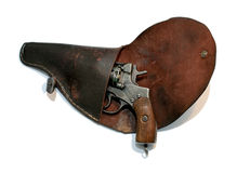 Old loaded revolver in a holster Stock Photo