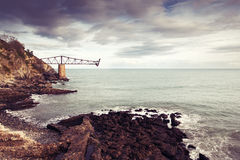 Old loading coal on the coast of Mioño, Cantabria, Spain Stock Photo
