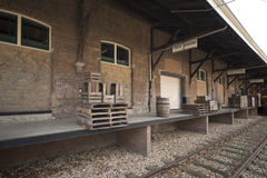Old loading dock. With pallets and train Royalty Free Stock Photography