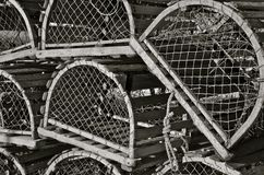 Old Lobster Traps. (Black and White) Old rounded wood lobster traps stacked upon each other on a fishing dock Royalty Free Stock Images