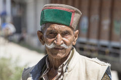 Old local man in Manali, India. MANALI, INDIA - SEPTEMBER 14, 2014: Old unidentified local man, outdoor in Manali . The majority of the local population are Stock Image