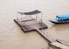 Old local pontoon with the long tail boat. Stock Photos