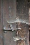 Old lock. In black door made of wood royalty free stock photo