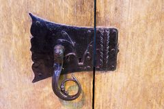 Old Lock. Very old cast iron ornate cabinet catch/lock Royalty Free Stock Photo