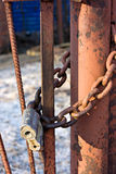 Old Lock and chain on fence. Royalty Free Stock Photography
