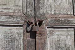 Old lock in detail in a wood door Royalty Free Stock Photography