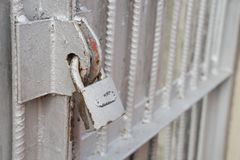 Old lock on the door. lock on the door of an old farmhouse . true village style . close-up. focus on lock royalty free stock photo