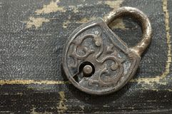 The old lock isolated on a leather background Royalty Free Stock Photography