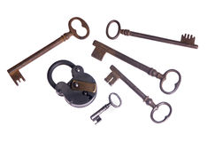 Old lock and keys. An old lock with an assortment of keys.. unlocking the past Stock Image