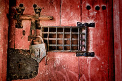 Old Lock and Locking Hardware on Antique Jail Door stock photography