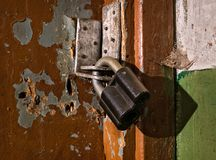 Old lock. Macro. Old production lock. Interior of an industrial building. The old door stock images