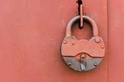 Old lock on metal door Stock Photos